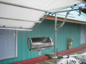 Force 10 barbeque rotates on bimini post mount