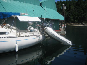 draining the water out of the dinghy prior to lifting on davits
