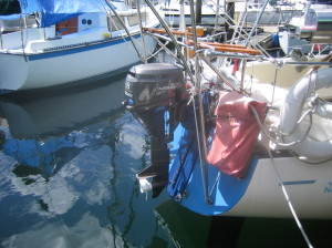 stern mounted 4 stroke retractable outboard in raised position